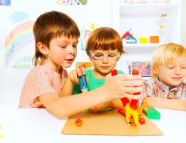 three male students playing with toys