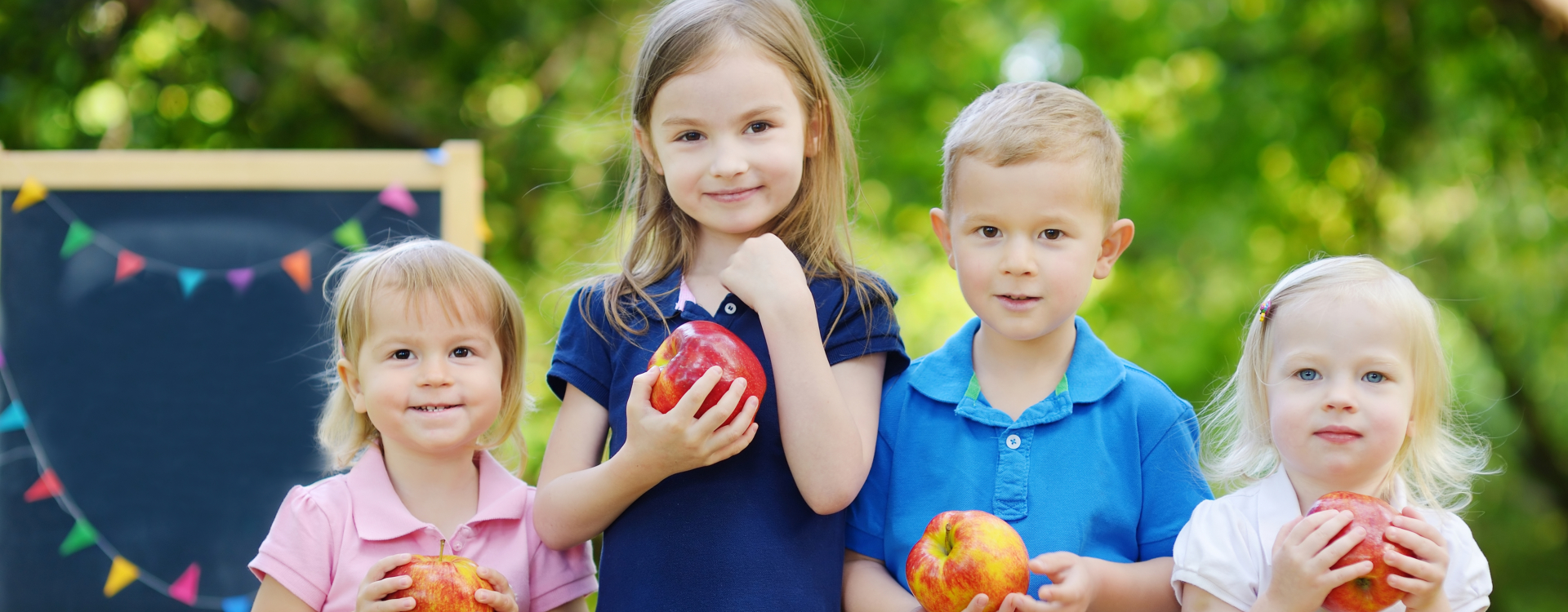happy students holding a apple